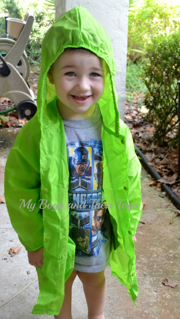 L with green raincoat
